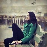 Beutiful Girl In Green Dress Sitting Alone