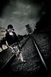 Beutiful Girl Walking On Railway Track