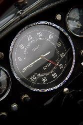 Black Ferrari Curves Speedometer