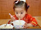 Chinese Girl Eating Chowmin