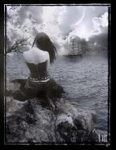 Girl Staying On Rock Near Sea