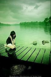 Lonely Girl On Bridge Near Sea